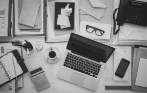 Header-Papers-and-Laptop